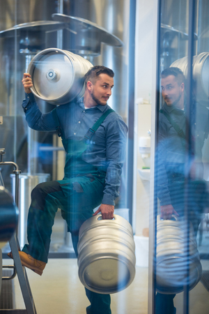brewery: Brewer carrying keg at brewery