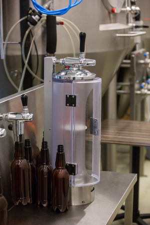 beer pump: Close-up of beer pump at bewery