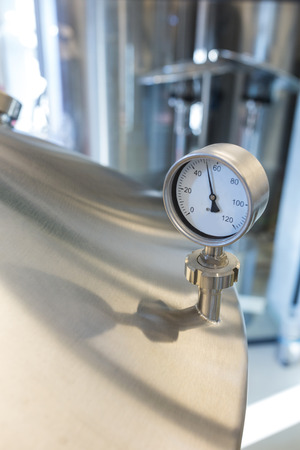 brewery: Close-up of barometer on distillery at brewery Stock Photo