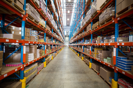 tidy: View of goods are tidy on shelves in a warehouse Stock Photo