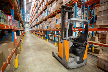 pallet truck: View of pallet truck and goods tidy in a warehouse Stock Photo