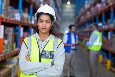 crossing arms: Worker crossing arms in warehouse