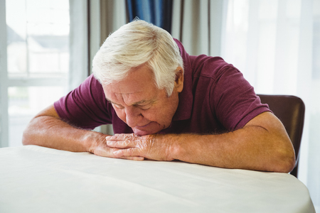 retirement home: An old man is lying on the table in a retirement home Stock Photo