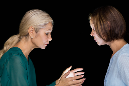 hypnotist: Hypnotist hypnotizing woman against black background