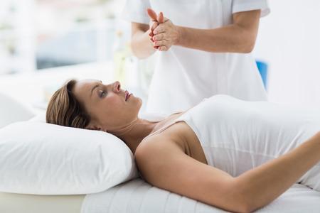 reiki: Woman receiving reiki treatment at spa