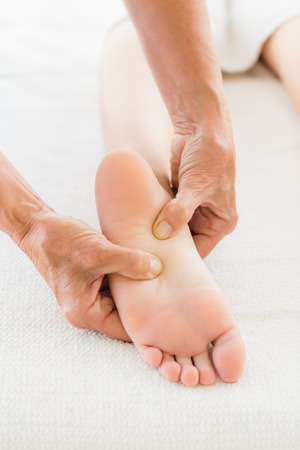 Receiving: Cropped image of woman receiving foot massage at spa