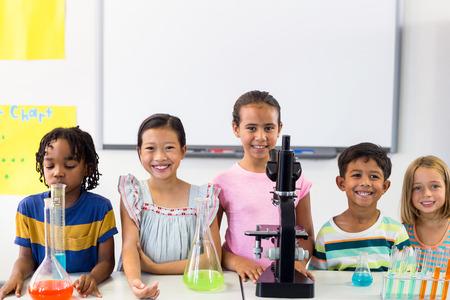 multi ethnic children: Portrait of multi ethnic children with scientific equipment in laboratory at school