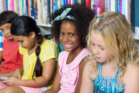classmates: Portrait of cheerful girl with classmates in library