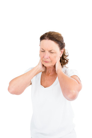 senior man on a neck pain: Mature woman suffering from neck pain while standing against white background