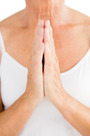 cropped out: Midsection of woman praying against white background Stock Photo