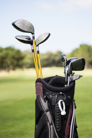 golf bag: Focus on foreground of a golf bag on field