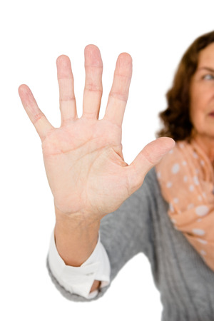 cropped out: Cropped image of woman showing stop sign against white background Stock Photo
