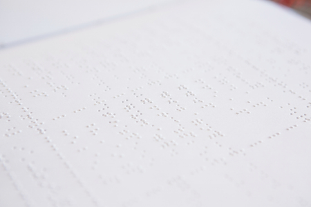 assistive: Close-up of braille book in classroom Stock Photo