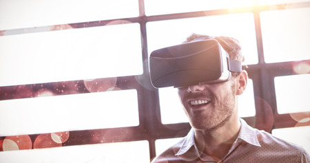 virtual office: Businessman using virtual reality device in the office Stock Photo