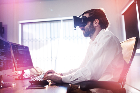 virtual office: Businessman wearing virtual glasses in a office Stock Photo