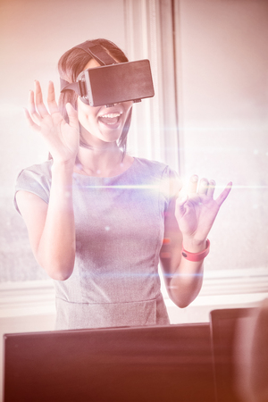 swivel: Business woman using 3D glasses in office Stock Photo