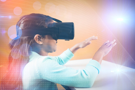 Girl using a virtual reality device at school Stock Photo