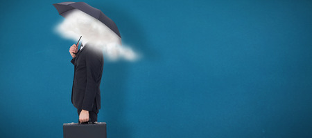 smother: Businessman under umbrella while holding a briefcase against blue background Stock Photo