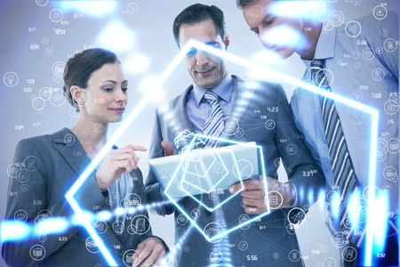 well dressed woman: Businessman showing tablet to his colleagues  against sphere of icons Stock Photo