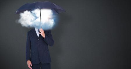 smolder: Businessman holding umbrella on white background against grey background