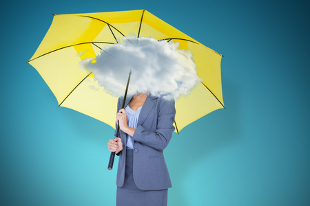 smother: Full length portrait of smiling businesswoman holding yellow umbrella  against blue vignette background Stock Photo