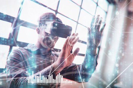 virtual reality: Various graphs and connectivity points  against businessman using virtual reality device Stock Photo