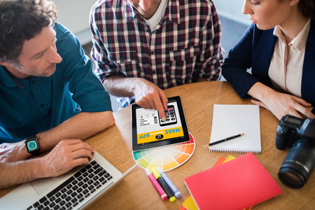 mid adult men: Make your own app smartphone against photographer having a meeting Stock Photo