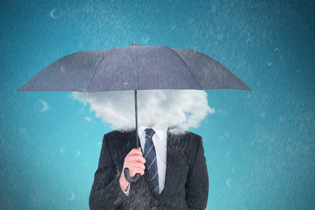 unsmiling: Unsmiling businessman sheltering under umbrella against blue vignette background