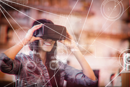 connectivity: Various graphs and connectivity points  against young woman using the virtual reality headset