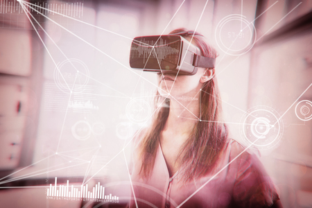 connectivity: Various graphs and connectivity points  against graphic designer using virtual reality headset in office