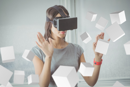 woman floating: Digitally generated grey cubes floating  against business woman using 3d glasses