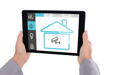 cropped shots: Cropped hand of man holding digital tablet against screen with information about home Stock Photo