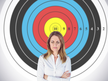 dreariness: Upset businesswoman with eyes closed against digital image of a target Stock Photo