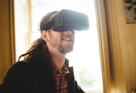 virtual reality simulator: Close-up of man using virtual reality simulator at home