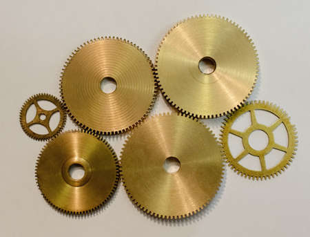 Collection of various gears on white paper in workshop LANG_EVOIMAGES