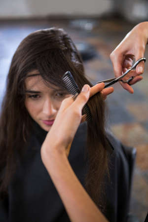 trimmed: Female getting her hair trimmed at a salon