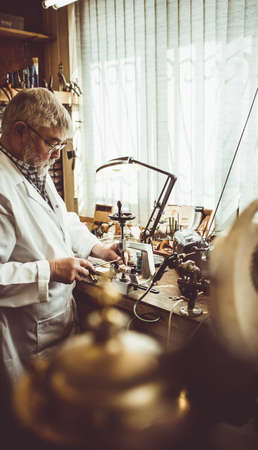milling machine: Horologist using a horological milling machine in the workshop