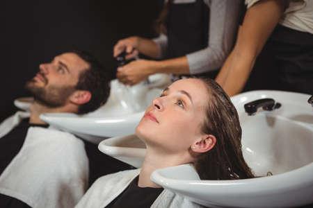 rinsing: Clients getting their hair wash at the salon