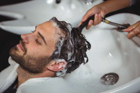 man hair: Man getting his hair wash at a salon LANG_EVOIMAGES