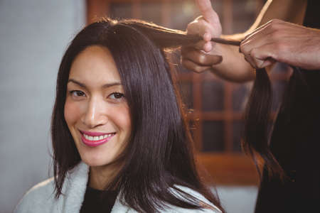 hair stylist: Male hairdresser with hair stylist in salon
