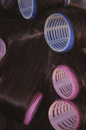 hair roller: Woman with blue and pink hair rollers at a salon