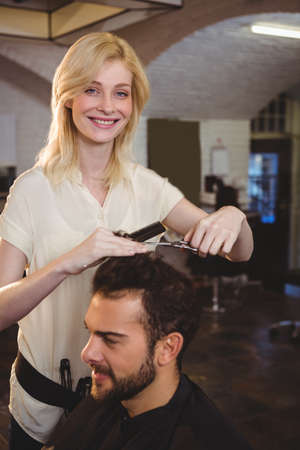 trimmed: Man getting his hair trimmed at the hair salon LANG_EVOIMAGES
