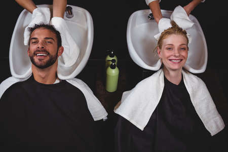 hair stylist: Hair stylist drying clients hair with towel in salon LANG_EVOIMAGES
