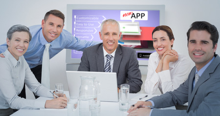 western script: Business team looking at camera against computer graphic image of mobile application concepts Stock Photo