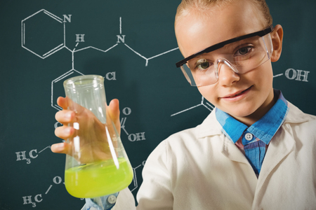 experimentation: Girl dressed as a chemist against science formula Stock Photo