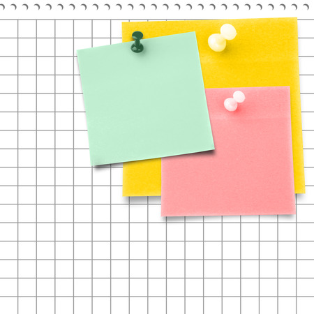 thumbtack: Yellow sticky note with thumbtack against spiral notepad Stock Photo