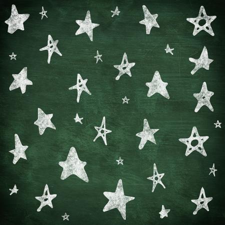 green chalkboard: Star drawings against green chalkboard