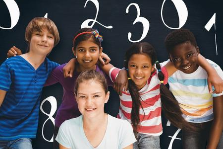 huddle: Happy children forming huddle at park against blackboard