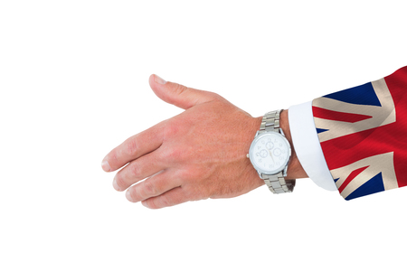 great suit: Businessman in suit clenching fists against digitally generated great britain national flag