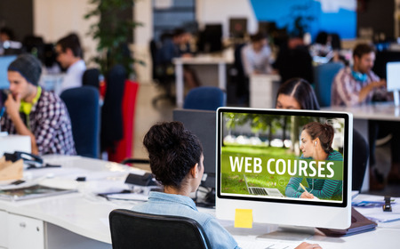 Web course ad against people working on computer Stock Photo